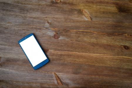 smart phone  on old wooden background photo
