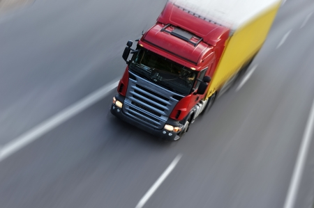 moving truck: truck with freight moving fast