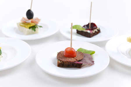 sandwiches with slices meat on wooden chopsticks photo