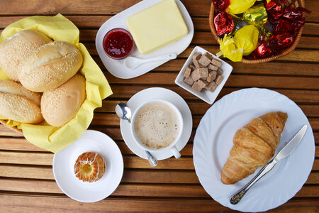 food for breakfast. buns, croissant and cup of coffee photo