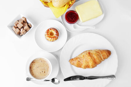food for breakfast.coffee, croissant, butter and jam photo