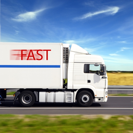 truck with freight moving fast photo