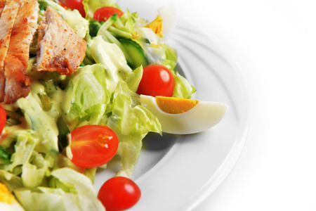 Fresh salad with lettuce, cherry  tomato and meat on dish photo