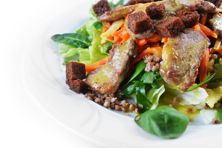 salad of marinated pork, spinach and buckwheat photo