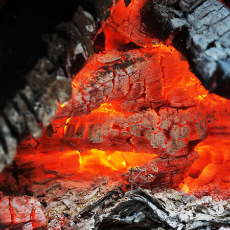 Burning down fire. Last embers and ashes Stock Photo