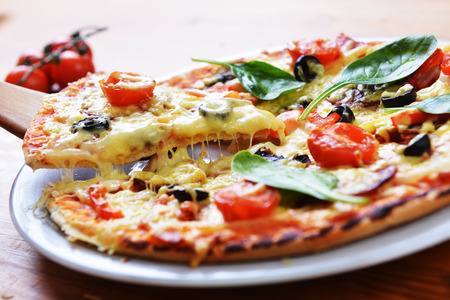 diferent:  baked pizza with diferent ingredients