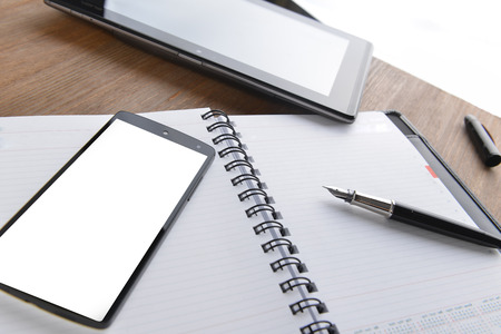 open notebook, mobile  phone and black  pen on white background photo