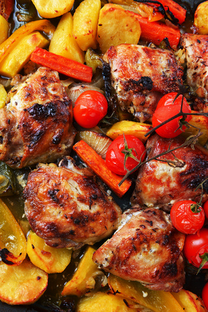 vegetables and chicken in pan baked in oven photo