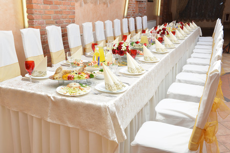 Wedding reception. tableware and food waiting for guests photo
