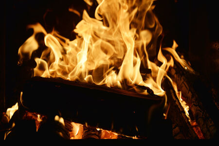 fire in fireplace close up photo