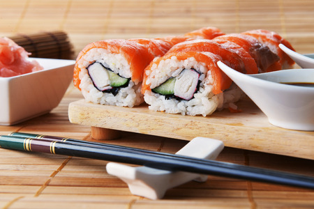 sushi with salmon and avocado on wooden background photo