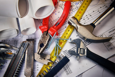 construction tools: project drawings  and tools on table