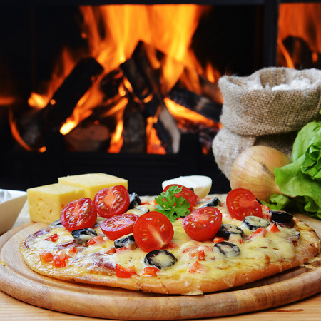 baked tasty pizza  near wood oven