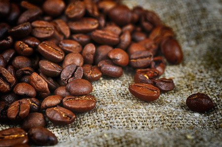 descriptive colours: roasted coffee beans  on sacking, background