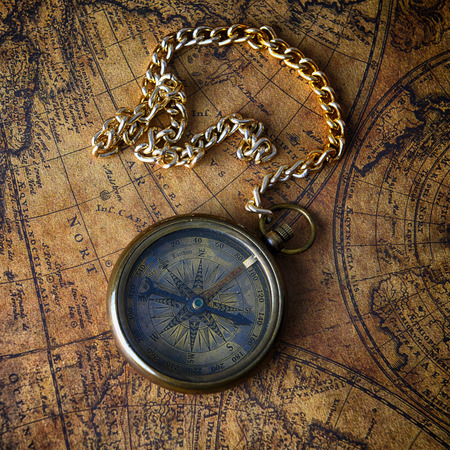Vintage Compass On Old Map Photo