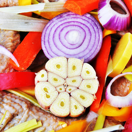 vegetables and chicken, prepared for roasting photo