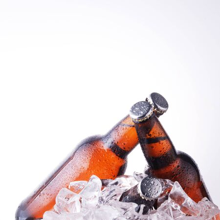 beer bubbles: brown bottles of beer chilling on ice Stock Photo