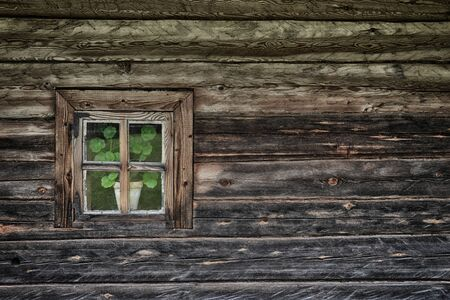 Old-fashioned window of wooden house Stockfoto