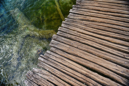 bridge over water: Wooden bridge over water surface of lake Stock Photo
