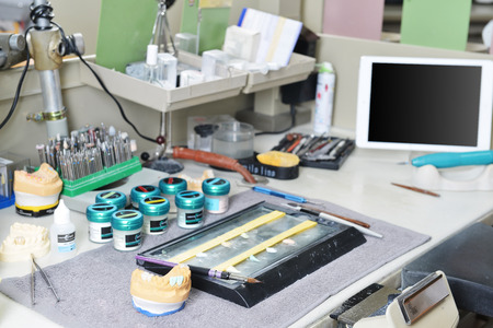 prosthodontics: dental technician table with dental tools.