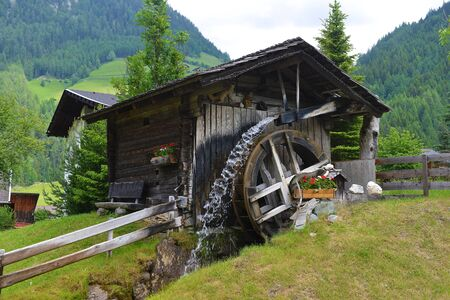 old grist mill: old wooden mill on mountain