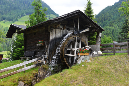 old grist mill: old wooden mill in mountains. mountain landscape Stock Photo