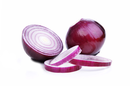 sliced red onions on  white background Stock Photo