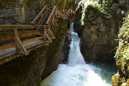 runoff: rapid mountain  brook flowing over rocks