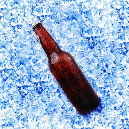 condensation: brown beer bottle in ice bucket with condensation