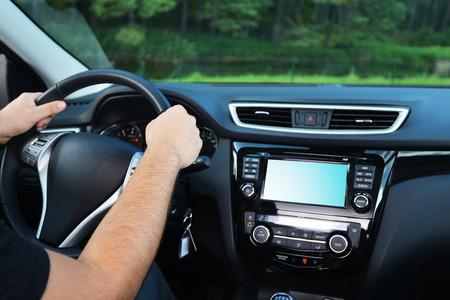 car inside: Driver hands steering wheel