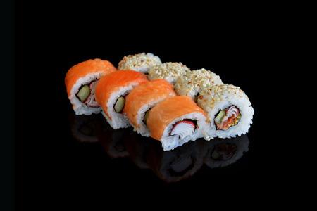 SUSHI: Delicious sushi rolls  on black background