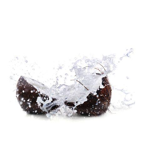 copra: cracked coconut with big splash Stock Photo