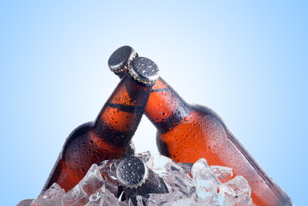 beer bottle: brown bottles of beer chilling on ice Stock Photo