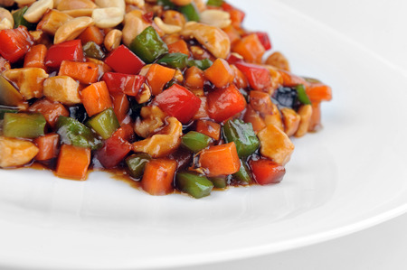dinners: steamed vegetables and meat with  peanut on plate. Chinese cuisine.