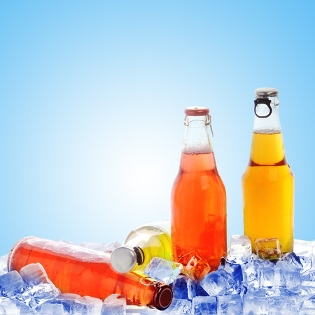 dew cap: bottles with  tasty drink in ice