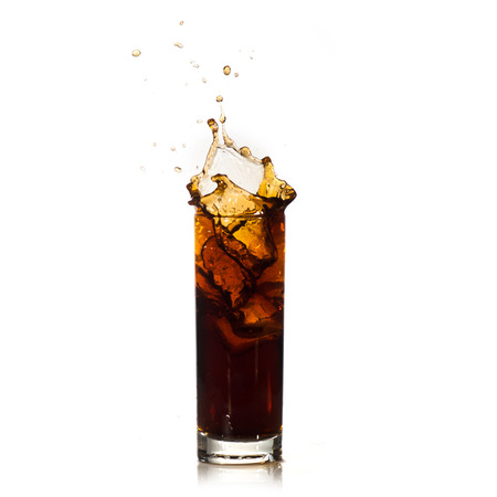 alcoholic drink: ice drops into cola with splashes