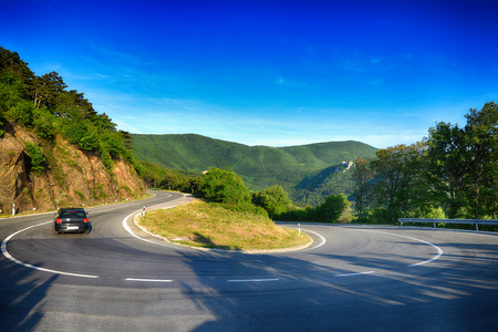 modern road in wooded mountains Stock Photo