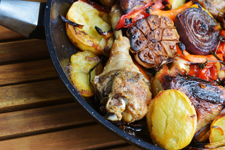 oven chicken: vegetables and chicken in pan baked in  oven Stock Photo