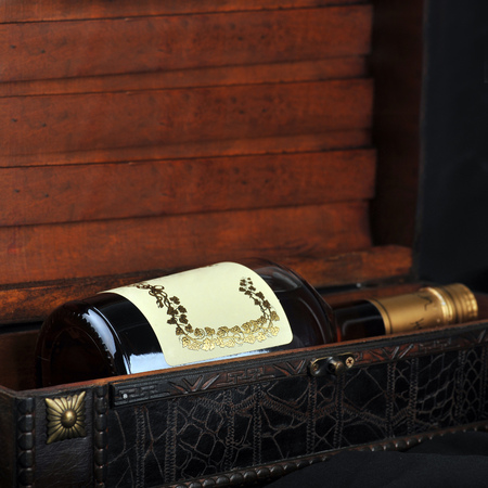 boxs: Cognac bottle in wooden case  background