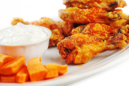 hot wings: A dish of chicken hot wings and carrots with dipping sauce