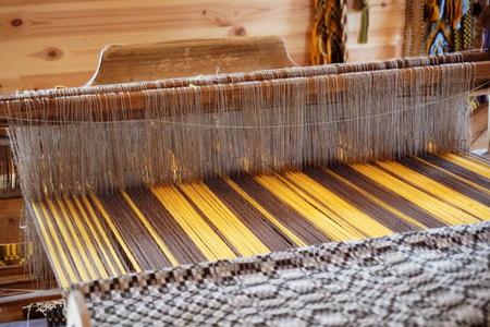 loom: traditional hand-weaving loom in room Stock Photo