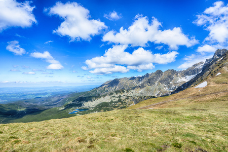 cloud capped: mountain peaks and blue sky Stock Photo