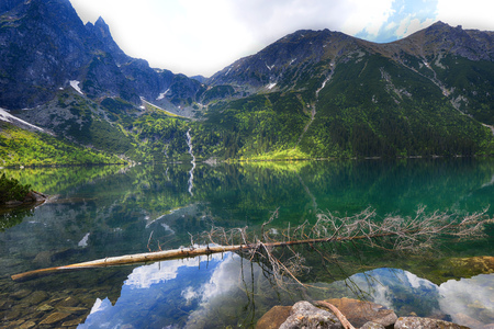 water flow: clear lake among mountain ranges Stock Photo