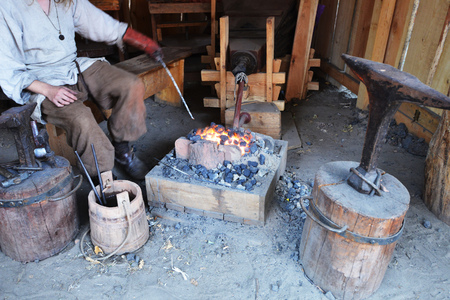farriery: small smithy with fire and anvil