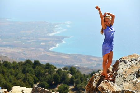 young woman on top of mountain photo
