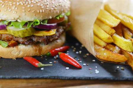 seed: Tasty and appetizing hamburger with fries Stock Photo