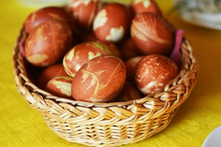 Easter eggs dyed onion skins in  basket