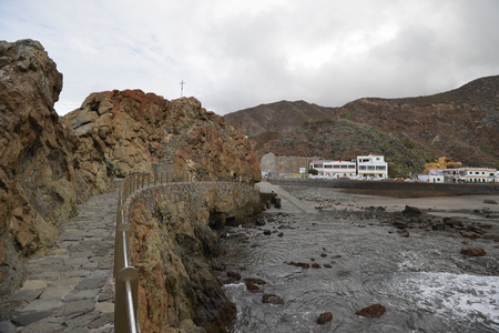 Resort town on rocky coast of ocean.