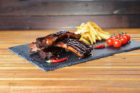 fried potatoes and pork ribs  plate Stock Photo