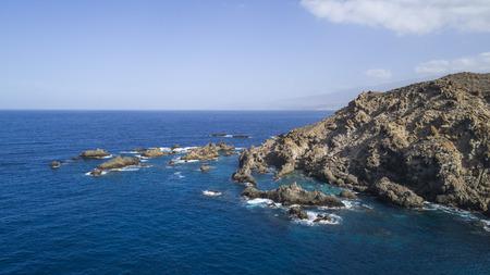 sky above rocks and stony coast. Sea landscape